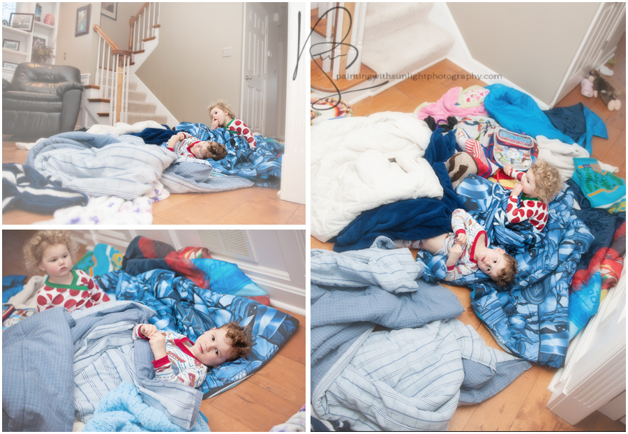 Two kids play and snuggle in a tangle of blankets