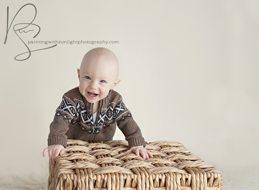 6 month old with big smiles in studio