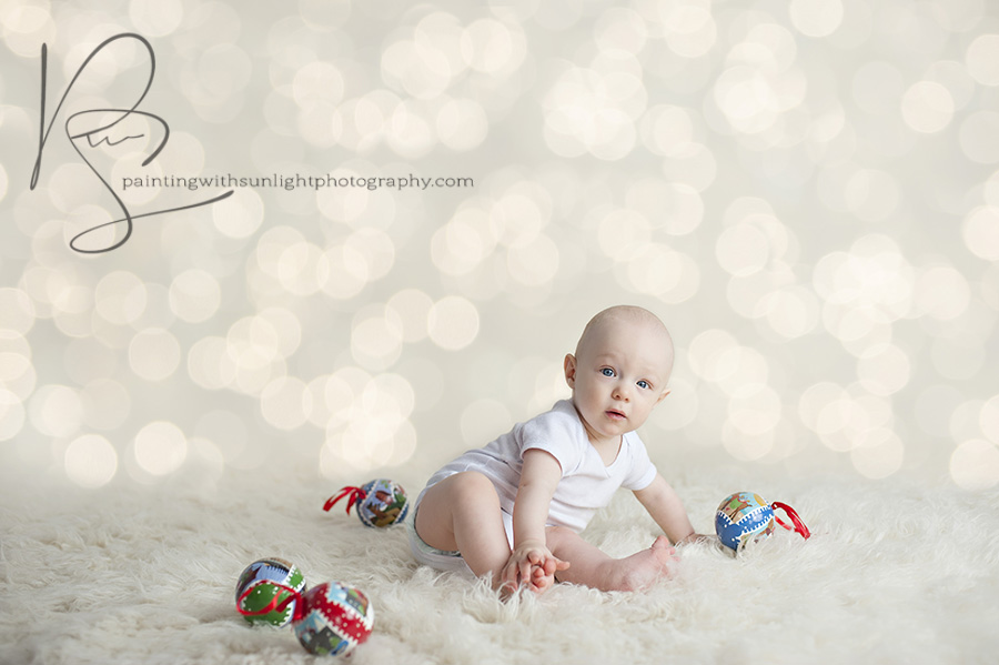 6 month old session with Christmas balls and twinkle lights