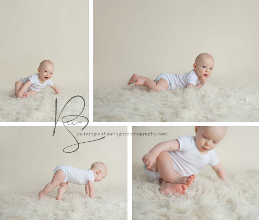 6 month old baby in white onsie on fluffy rug